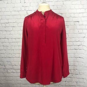 Red silk blouse by Amanda Uprichard